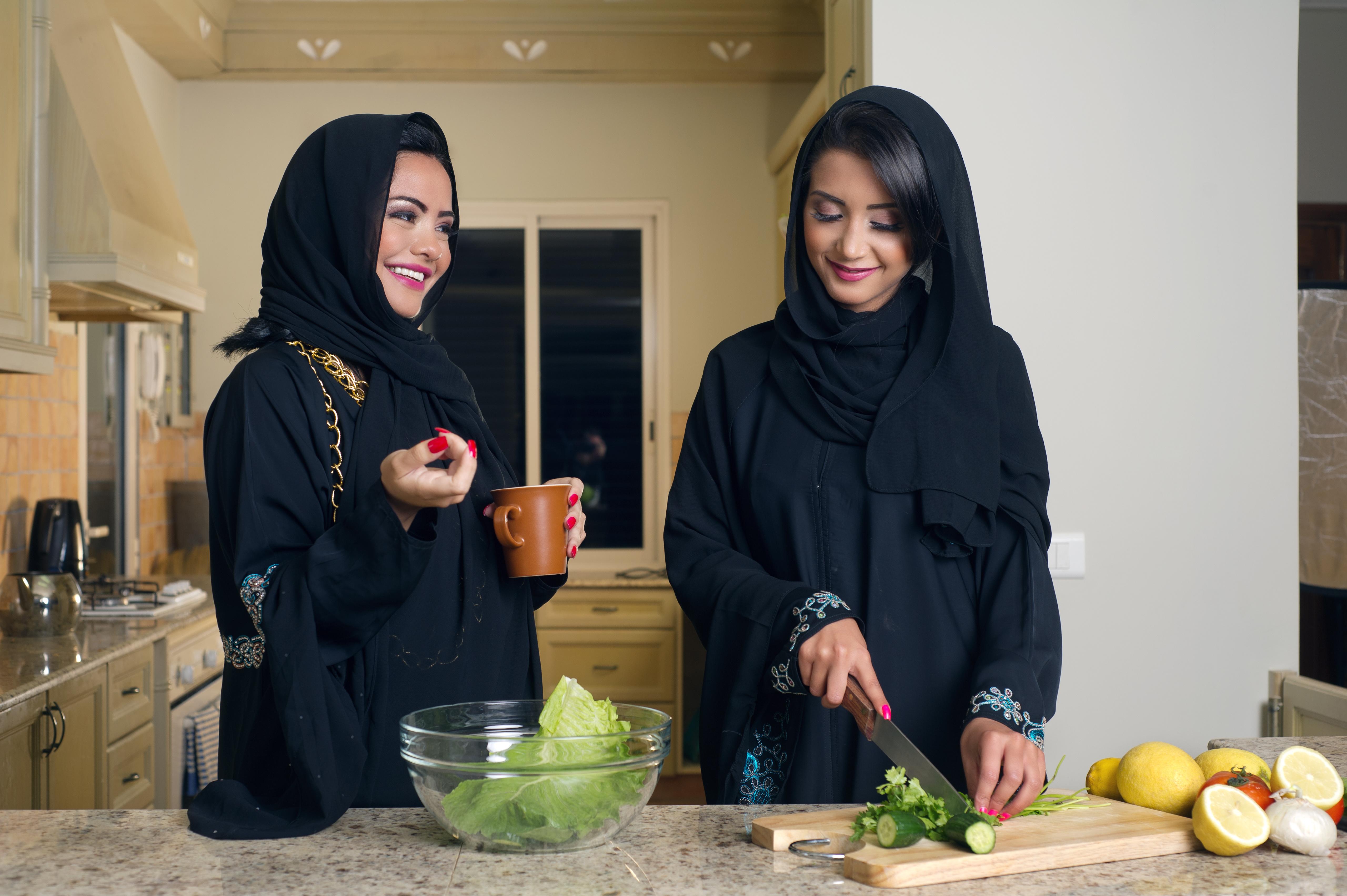 Two Arabian Women Cooking & Drinking coffee in the Kitchen